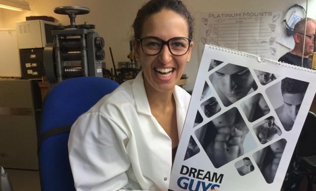 Audrey from Asprey holding Dream Guys Calendar